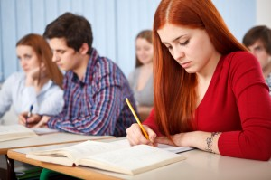 Group of students studying in classroom